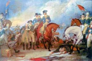 John Trumbull's Capture of the Hessians at the Battle of Trenton shows Monroe wounded.  He took a musket ball in the left shoulder.