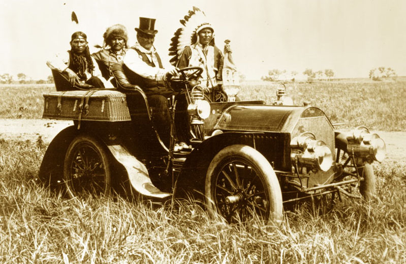 Geronimo driving in 1905. The car is a 1904 Model C Locomobile, and the Indian in full headdress to Geronimo's left is Edward Le Clair Sr., a Ponca Indian. Geronimo so admired Le Clair's beaded vest that it was presented to him later in the day. When Geronimo died in 1909, he was buied in the vest.