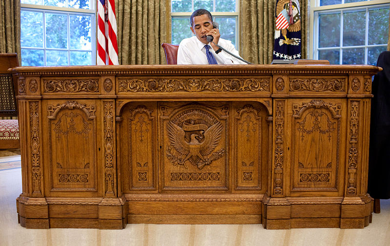 The Resolute Desk was originally given to President Wilson by Queen Victoria. FDR later had a central panel installed, with the carved image of the Presidential seal, to help conceal the fact that he was sitting in a wheel chair.