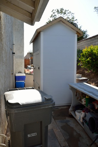 The shed backs up against a retaining wall, and still gives us 3' of clearance.