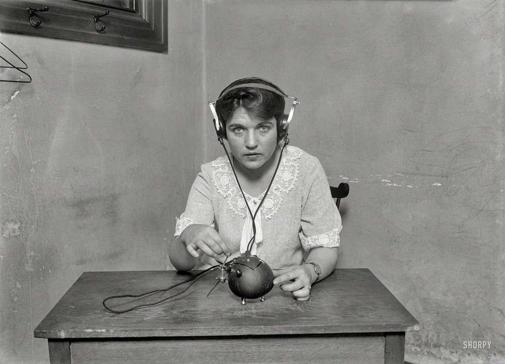 """June 1924. Washington, D.C. """"Radio nut -- this set with everything necessary for receiving music and speech by radio has been put into a coconut shell. It was built by H. Zamora, a native of Manila, Philippine Islands."""" Harris & Ewing Collection glass negative. Shorpy Historical Photos."""