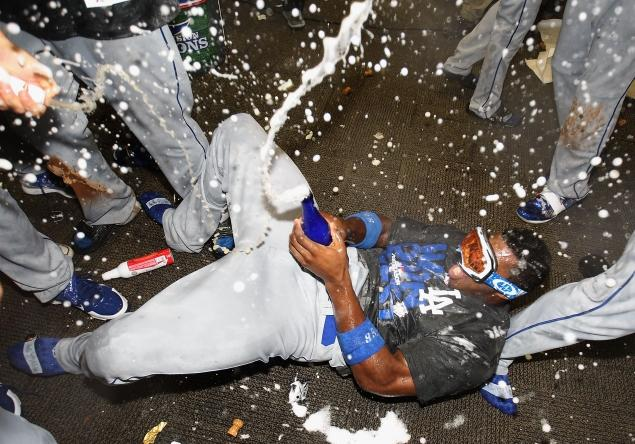 Yasiel Puig celebrates the LA Dodgers division championship. And then it got weird.... Christian Petersen/Getty Images