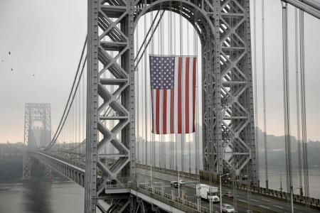 The largest free-flying American flag in the world flew over the George Washington Bridge Monday, Sept. 2, 2013, in Fort Lee, New Jersey, for Labor Day. The Port Authority of New York and New Jersey said the flag flew on Labor Day under the upper arch of the bridge's New Jersey tower, to honor working men and women across the country. The flag is 90 feet long by 60 feet wide, with stripes measuring about five feet wide and stars about four feet in diameter. (AP Photo/Mel Evans) (via Mowry Journal)