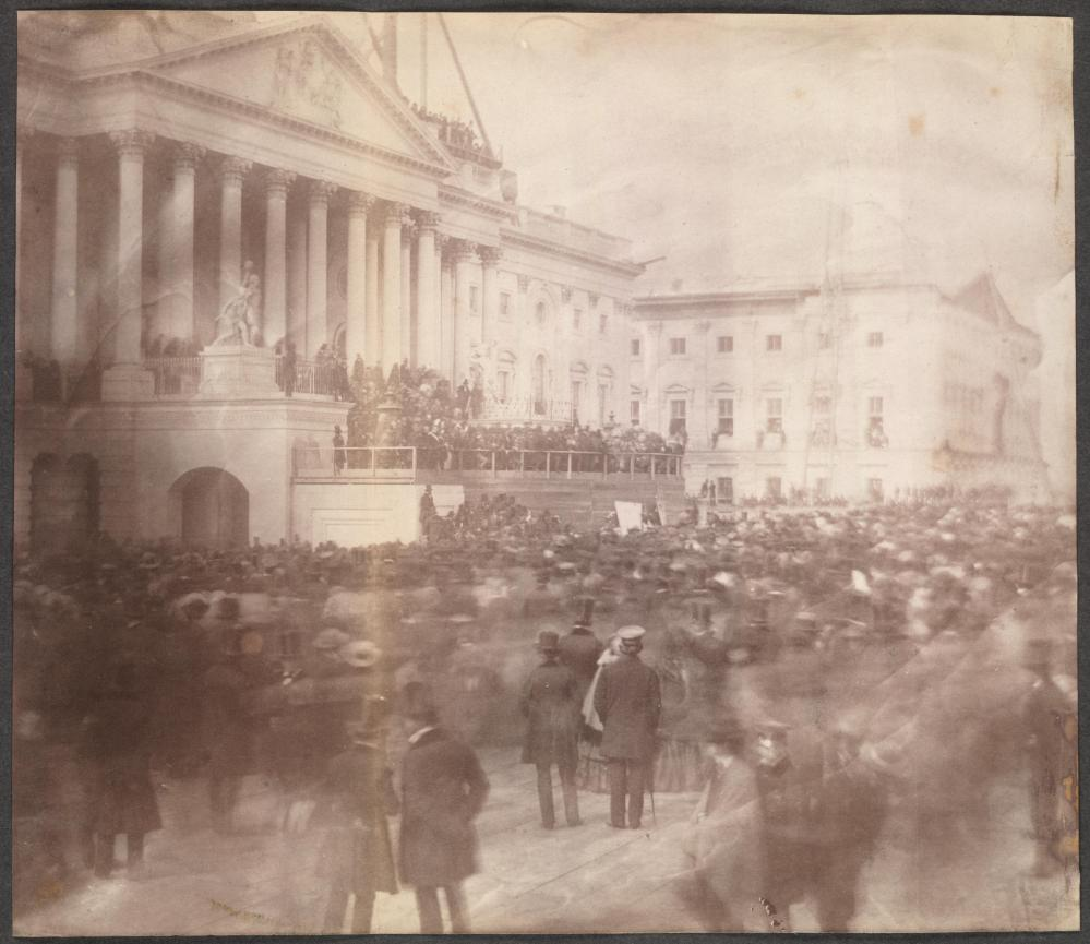 Inauguration of James Buchanan, President of the United States, at the east front of the U. S. Capitol, March 4, 1857. First photograph of an inauguration at the Capitol, which was still under construction in 1857. The stone yard in the foreground was covered with boards to provide a platform for the crowd. The life dates of the photographer, John Wood, are unknown, but he was the photographer for the Architect of the Capitol from 1856 to 1861. Mr. Wood then entered the war as a photographer of maps for McClellan.