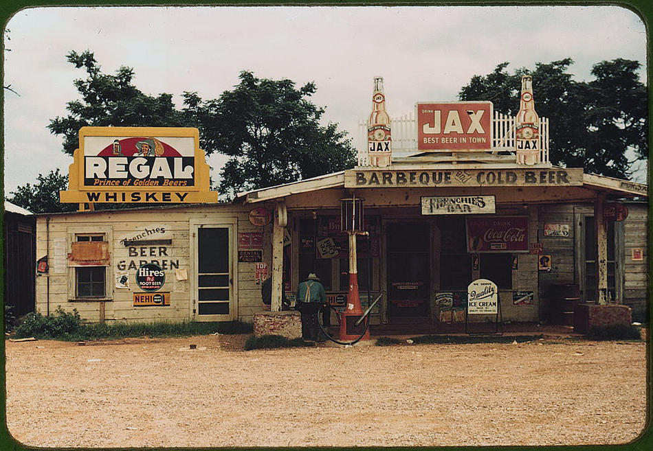 "A crossroads store, bar, ""juke joint,"" and gas station in the cotton plantation area. Melrose, Louisiana, June 1940. Reproduction from color slide. Photo by Marion Post Wolcott. Prints and Photographs Division, Library of Congress"