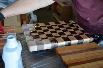 This is an end-grain cutting board: each board has been turned on end, so the knife will cut down on the grain, instead of across the grain. This design was made famous by The Wood Whisperer.