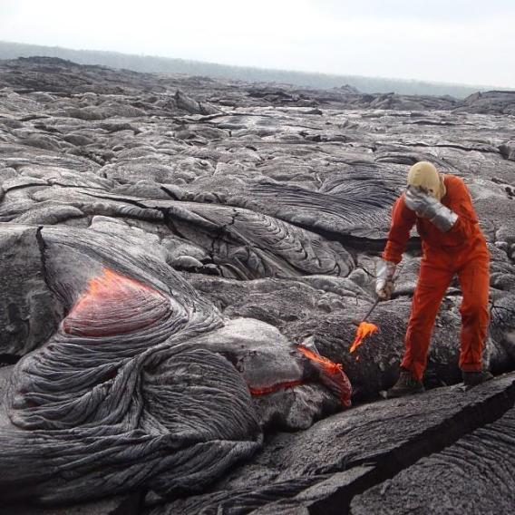 A geologist takes a lava sample in the Park. Tweeted by the US Department of the Interior 10/25/13.