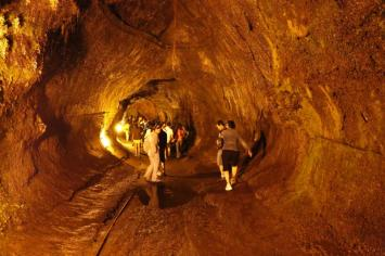 Group walking through Nahuku - Thurston Lava Tube. Michael Szoenyi. From the Park's website.