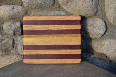 # 8 Cheese Board, $30. Red Oak, Walnut, Yellowheart.
