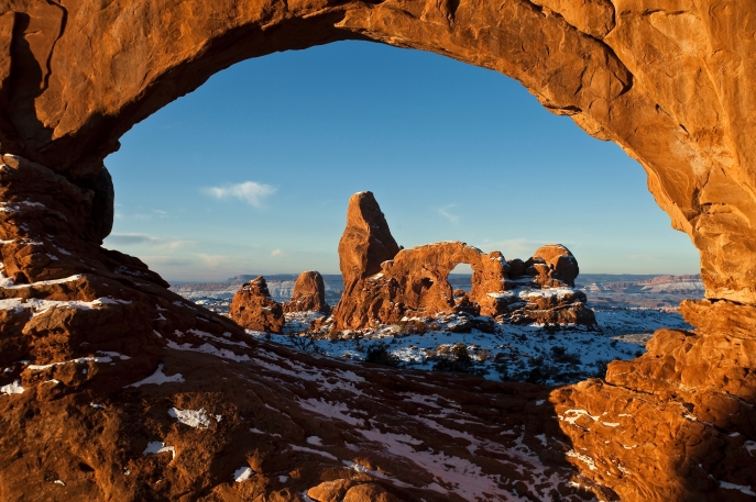 First Light on Turret Arch Framed by North Window. Photo by Jacob W. Frank. From the Park website.