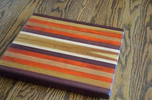 A fully restored board. The padauk is once again a vibrant orange.
