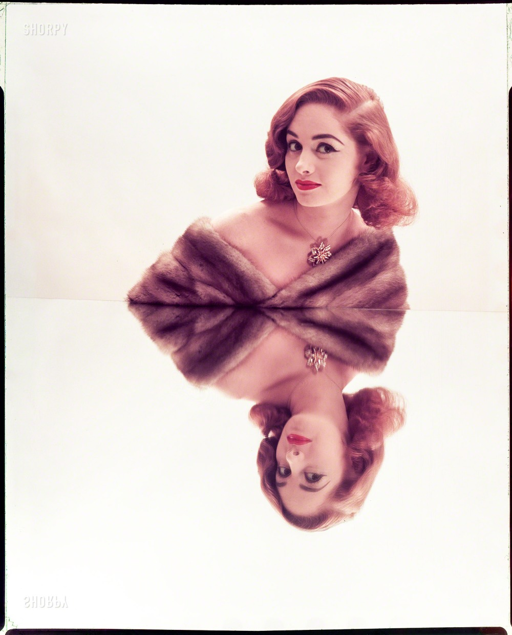 """July 1952. """"Photographs show models posed leaning shoulders against mirrors, resulting in reflected images. Includes women wearing furs and jewels; various hairstyles."""" Color transparency by Louis Faurer for the Look magazine assignment """"Reflected Beauty: Hair Now Gets Double Exposure."""" From Shorpy Historical Photos; see link below."""