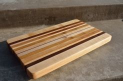 "This board stayed as a ""long grain"" cutting board: the grain runs the length of the board. Some prefer the checker board patterns of end grain cutting boards (which many butcher blocks have); others prefer long grain cutting boards."