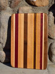 # 6 Cheese Board, $30. Red Oak, Hard Maple, Purpleheart, Cherry, Walnut, Yellowheart