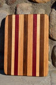 # 5 Cheese Board, $30. Red Oak, Walnut, Hard Maple, Purpleheart.