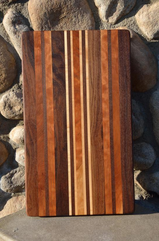 # 74 Cutting Board, $150. Walnut, Curly Cherry and Hard Maple.