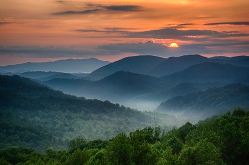 Gorgeous sunrise over Great Smoky Mountains National Park. Photo: Chris Mobley of Southern Scenic Photography. To purchase the image, go to http://fineartamerica.com/featured/smokey-awakening-christopher-mobley.html. Posted on Tumblr by the US Department of the Interior, 7/21/14.