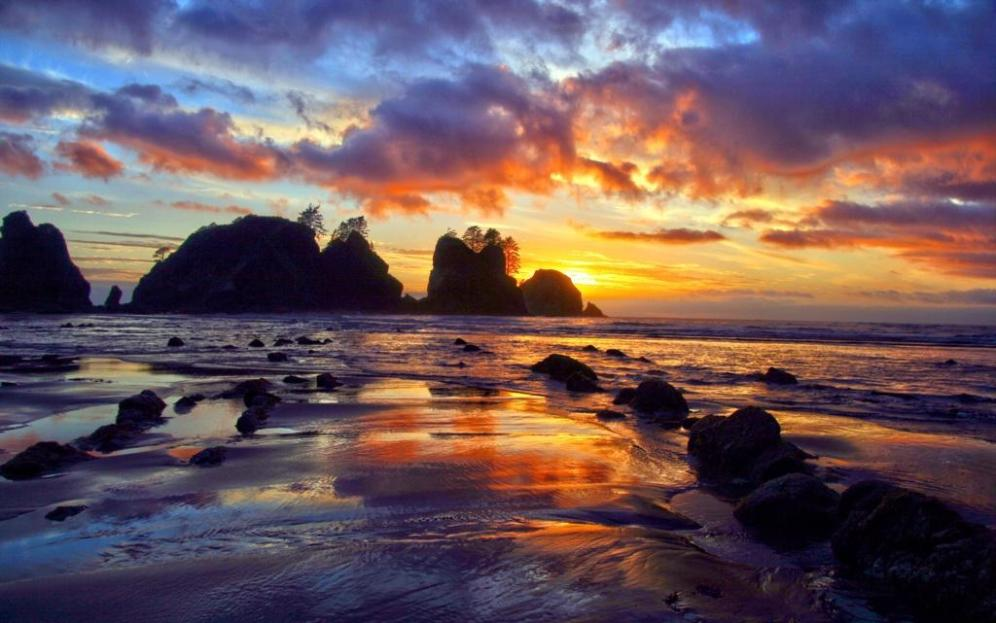 Sunset over Point of the Arches in Olympic National Park. Photo: Andy Porter. Posted on Tumblr by the US Department of the Interior, 8/5/14.