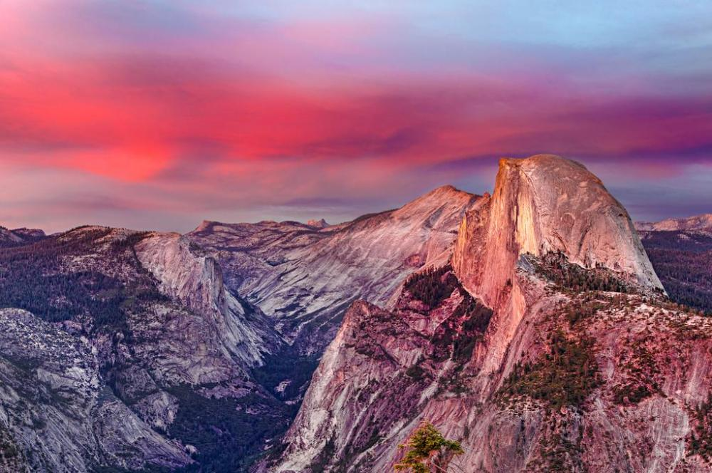 The monolith under a colorful sky, reflected onto the granite uplift that is Half Dome. Tweeted by the US Department of the Interior, 10/17/14.