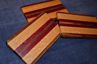 "Edge grain. Sold the only one exhibited on day one. Walnut, oak and purpleheart. 8"" x 12"" x 1""."