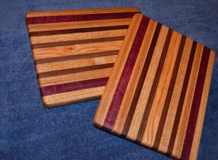"Edge grain. Sold the one exhibited on day one. Oak, purpleheart and walnut. 11"" x 8"" x 1""."