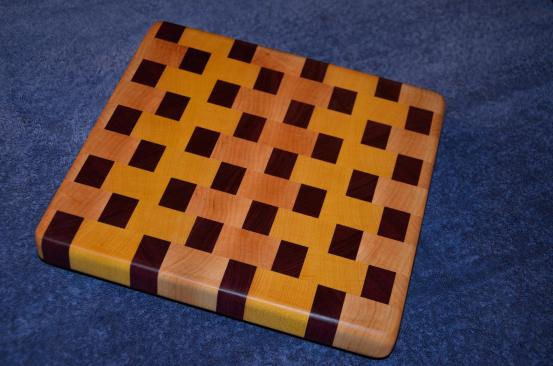 "# 32 Cutting Board, $50. End grain. 12"" x 12"" x 1-1/4"". Maple, purpleheart and yellowheart."