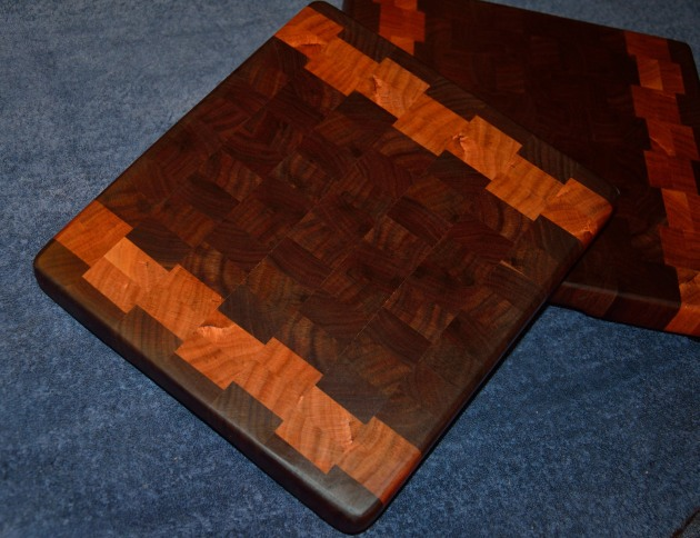 "# 51 Cutting Board, $60. End grain. Black walnut and cherry. 12"" x 12"" x 1-1/4"" thick."