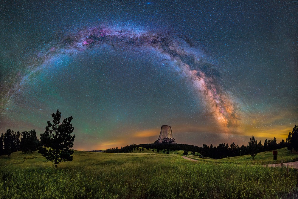 "America's first national monument, Devils Tower is a geologic feature that protrudes out of the rolling prairie in Wyoming. David Lane captured this amazing 16-image panorama of the monument illuminated by the Milky Way and green airglow. Of visiting Devils Tower, David says: ""From ancient stories of the Pleiades taking refuge at the top to the generations of Native Americas that held it sacred, it had a deep sense of age and a stoic nature that impressed me. It's so unexpected, so large in person, so steeped in traditions."" Posted on Tumblr by the US Department of the Interior, 11/13/14."