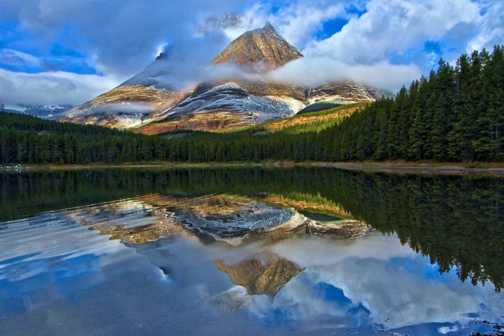 Glacier National Park in Montana is a sight to see in the fall! Adam Jewell captured this photo of Fisher Cap Lake on a frigid October morning. The low clouds, fog, a light dusting of snow and early morning sunlight helped create this amazing photo. Posted on Tumblr by the US Department of the Interior, 11/25/14.