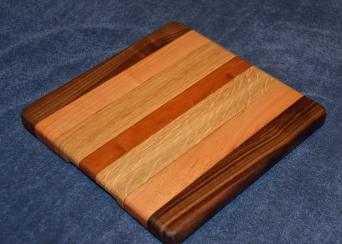 "Cheese board. Black Walnut, Cherry and White Oak. 10"" x 12"" x 1""."