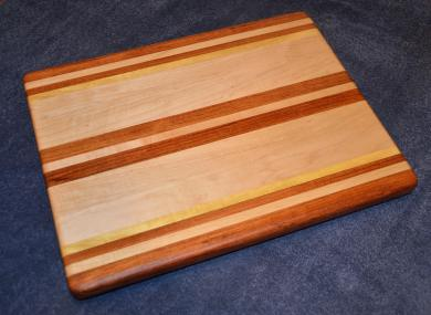 "Edge grain cutting board. Jatoba, Hard Maple and Yellowheart. 12"" x 16"" x 1-1/8""."