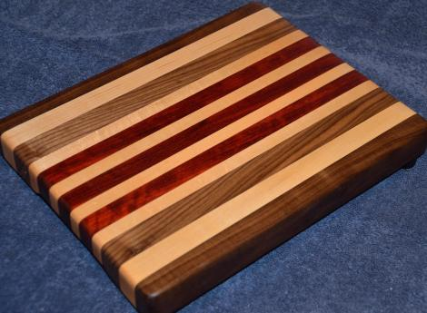 "Edge grain cutting board. Black Walnut, Hard Maple and Padauk. 10"" x 14"" x 1-1/4""."