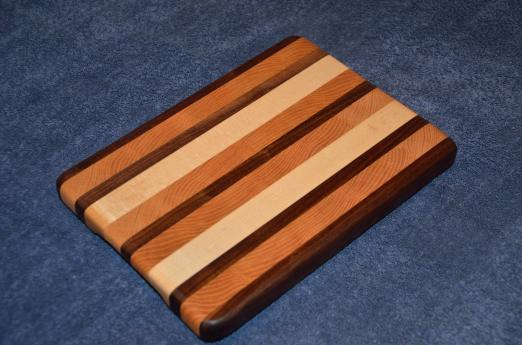 "Edge grain small board. Black Walnut, Honey Locust and Hard Maple. 8"" x 11"" x 1""."