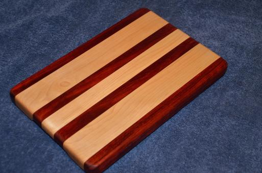 "Edge grain small board. Padauk and Hard Maple. 8"" x 11"" x 1""."