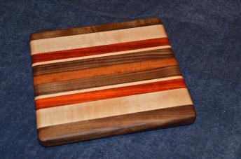 "Edge grain small board. Black Walnut, Hard Maple and Padauk. 8"" x 10"" x 7/8""."