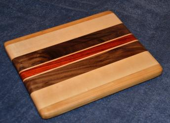 "Edge grain small board. Cherry, Hard Maple, Black Walnut and Padauk. 8"" x 11"" x 7/8""."