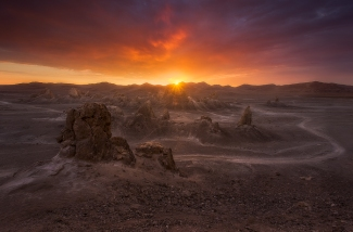 Trona Pinnacles is one of the most unusual geologic wonders in the California Desert. This unique landscape consists of more than 500 tufa pinnacles — some as tall as 140 feet — rising from the bed of the Searles Dry Lake basin. Michael Shainblum captured this dramatic photo of Trona Pinnacles at sunset, which is a popular time to visit the sight. When visiting this area, you will understand why more than 30 movies and commercials are filmed here every year. Ideally suited for science fiction backdrops Star Trek V, Tim Burton's Planet of the Apes and Battlestar Galactica were all shot here. Tweeted by the US Department of the Interior, 1/4/15.