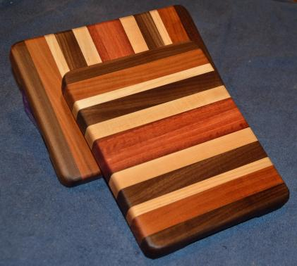 "Cheese Board # 15 - 005. Black Walnut, Cherry, Hard Maple & Jarrah. 7"" x 10"" x 1""."