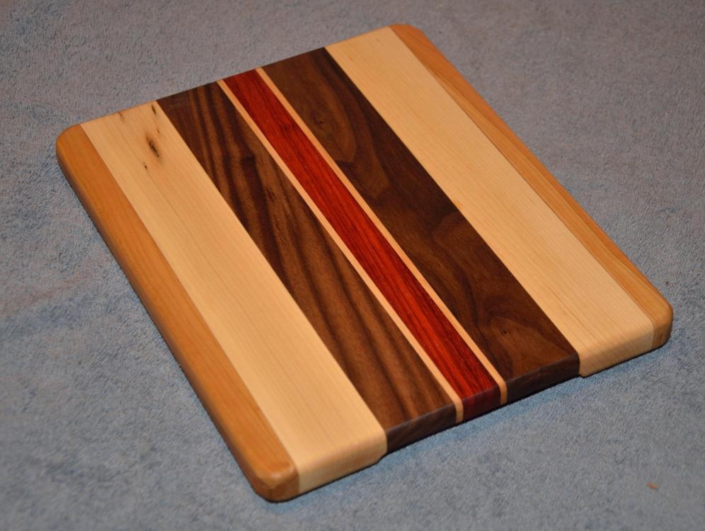 "Cheese Board # 15 - 009. Cherry, Hard Maple, Black Walnut and Padauk. 8"" x 11"" x 3/4""."