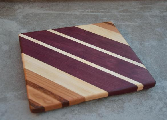 "Jatoba, Cherry, Hard Maple and Purpleheart cheese board. 10"" x 11"" x 7/8""."