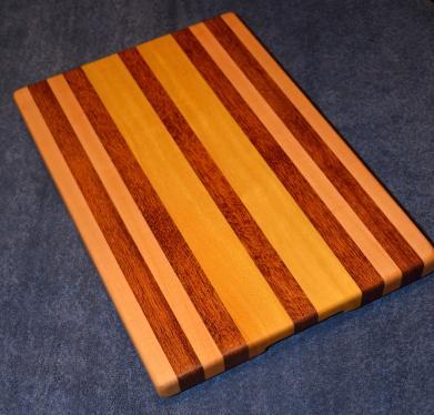 """Hard Maple, Jatoba and Yellowheart edge grain cutting board. 12"""" x 16"""" x 1-1/4""""."""