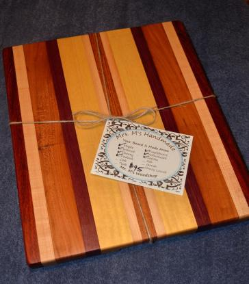 Boards are wrapped with a jute cord, and a tag is attached that identifies the woods used, gives the price, and has complete care instructions on the back. If the board is being given as a gift, then I remove the price tag and replace it with a tag that has all of the original information except for the price.