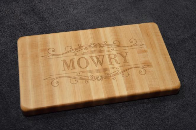 """Engraved # 15 - 01. Hard Maple with engraving on one side; the opposite side is plain and intended to use as a small cutting board. 7"""" x 12"""" x 1-1/8""""."""