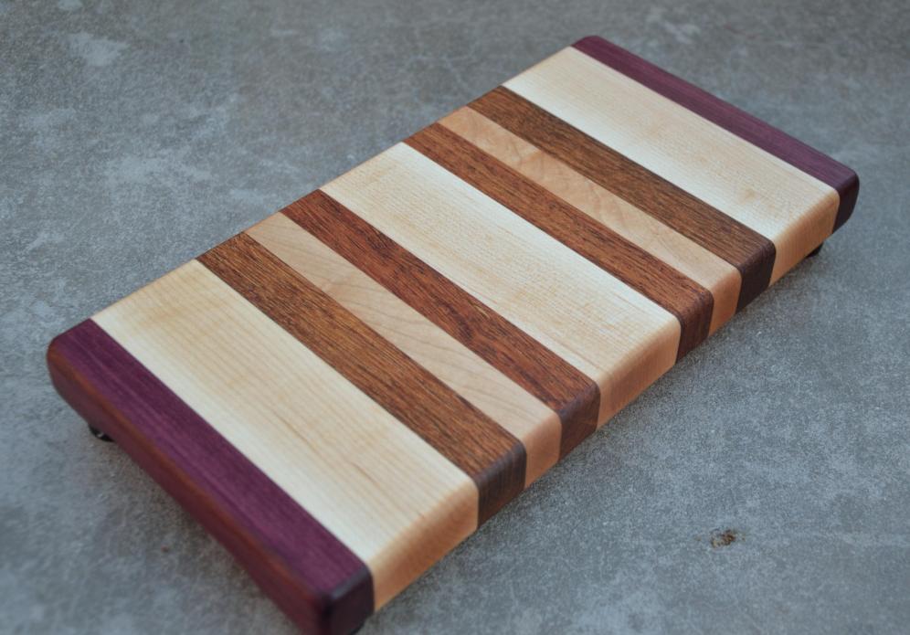 "Purpleheart, Hard Maple and Jatoba edge grain board. 6"" x 12"" x 1-1/4""."