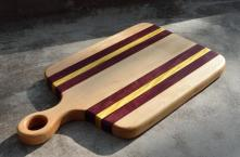"Sous Chef # 15 - 09. Hard Maple, Purpleheart and Yellowheart. 9"" x 15"" x 1""."