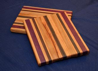 """Cheese Board # 15 - 018. Honey Locust, Purpleheart, Black Walnut and Cherry Edge Grain. 9"""" x 11"""" x 3/4""""."""