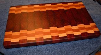 "Cutting Board # 15 - 024. Spectacular color and grain patterns make this a board a visual treat. Jarrah, Hard Maple and Cherry end grain. 13"" x 19"" x 1-1/2""."