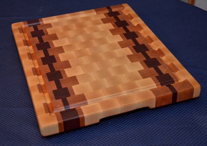 "Cutting Board # 15 - 037. Hard Maple, Cherry and Jarrah End Grain. Juice Groove with resevoir ends. 16"" x 20"" x 1-1/2""."