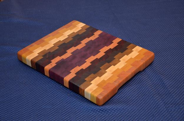 """Small Board # 15 - 035. Cherry, Yellowheart, Hard Maple, Jatoba, Purpleheart, Padauk and Honey Locust End Grain. 13"""" x 11"""" x 1-1/4""""."""