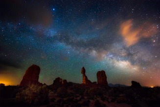 Balanced Rock at Arches National Park in Utah beneath the amazing Milky Way and night sky. The park has over 2,000 natural stone arches, in addition to hundreds of soaring pinnacles, massive fins and giant balanced rocks. This red rock wonderland will amaze you with its formations, refresh you with its trails, and inspire you with its mesmerizing night skies. Photo courtesy of Mike Mezeul II. Tweeted by the US Department of the Interior, 5/24/15.